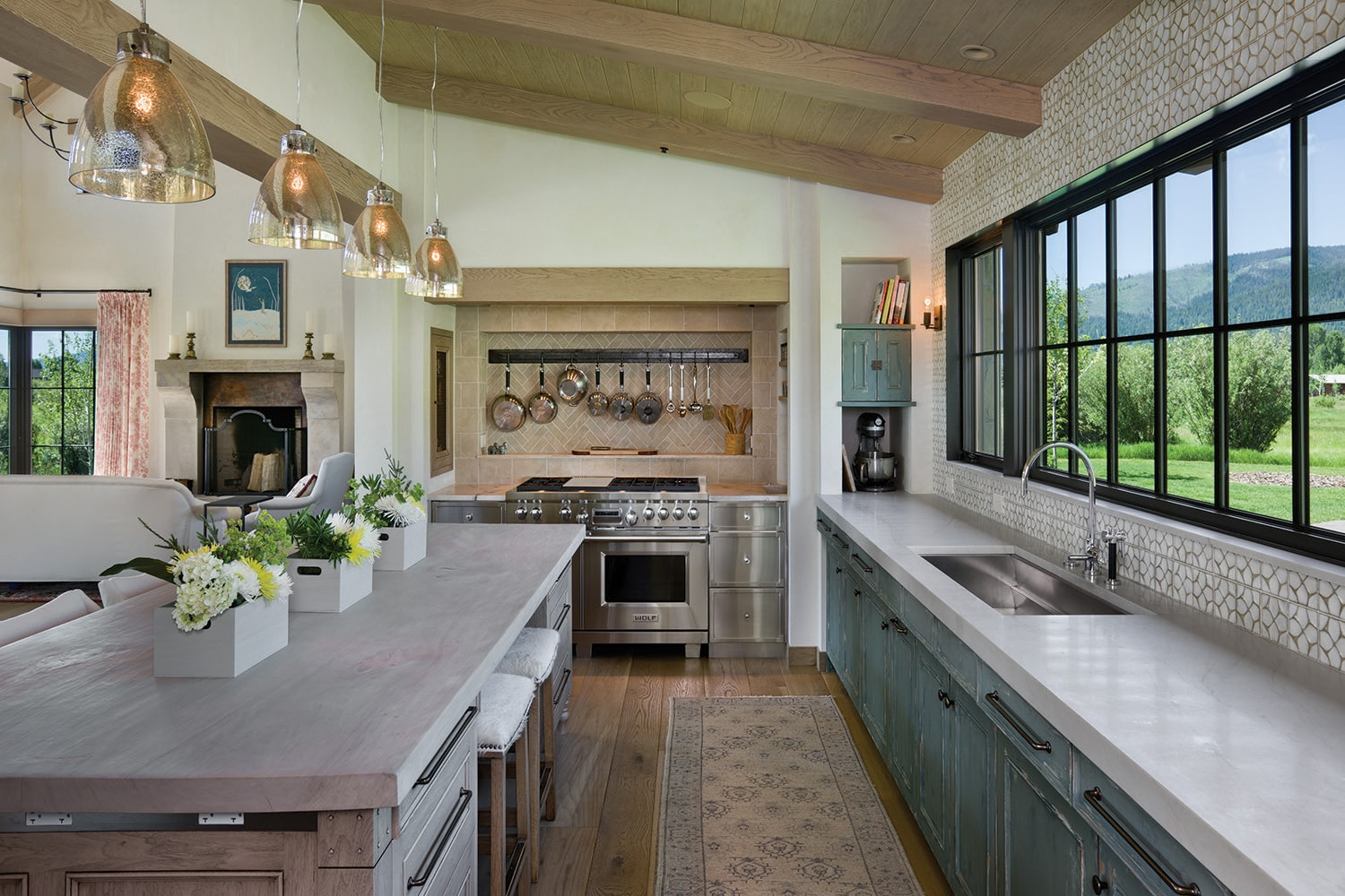 The kitchen features design and cabinetry by de Giulio Design.