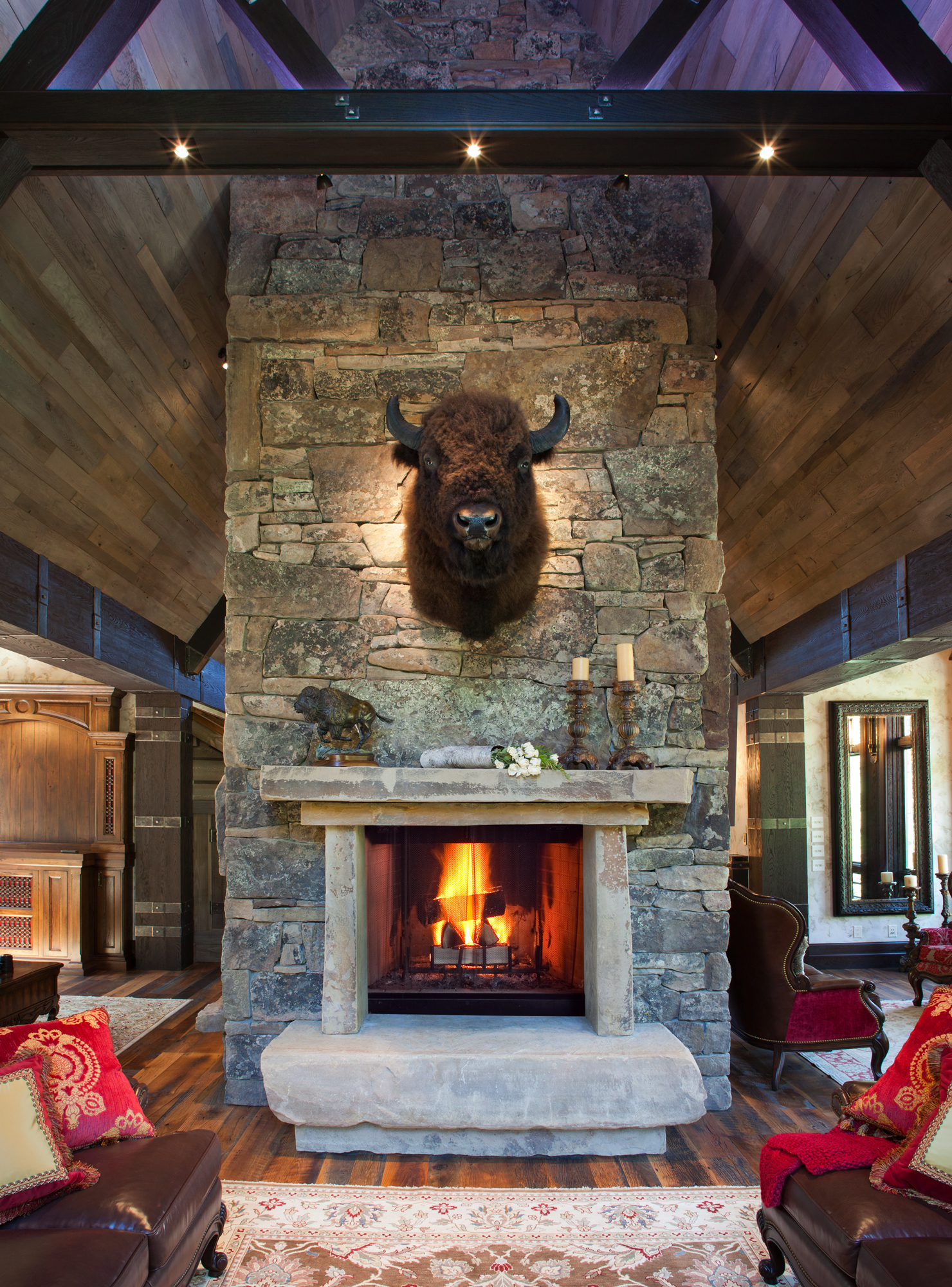 montana regal anchoring the montana moss rock fireplace in the great room the stately buffalo. Black Bedroom Furniture Sets. Home Design Ideas